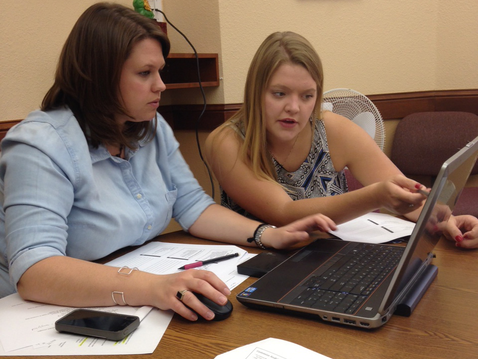 Victoria (right) working with our Education and Marketing Manager Ashley Collins.